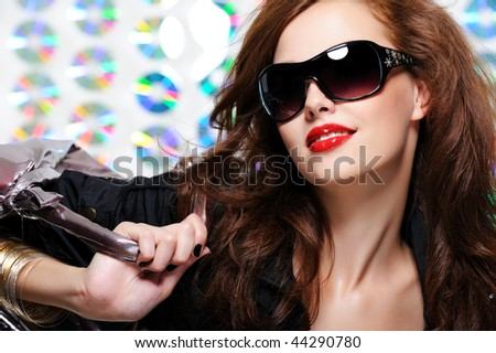 glamour beautiful young woman with fashion sunglasses and handbag - stock photo