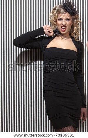 Glamour beauty in a black dress in retro style - stock photo