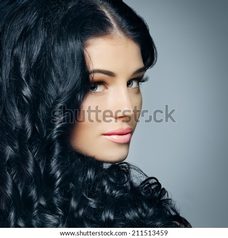 Glamour beauty woman brunette with beautiful shiny hair and makeup - stock photo