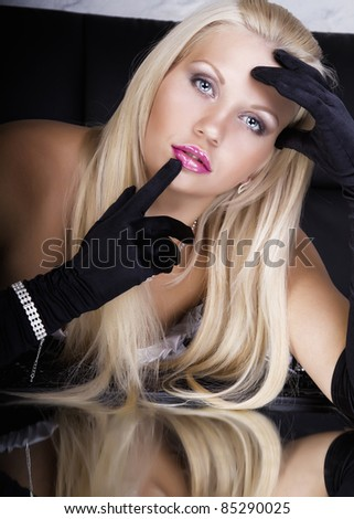 Glamour blonde with black gloves - stock photo