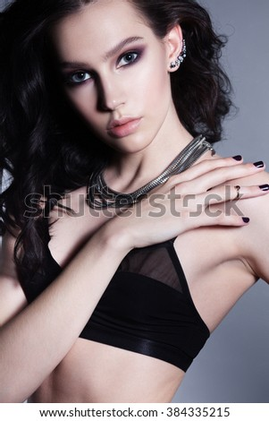 Glamour Brunette Curly Young Woman Posing In Lingerie. Beautiful Fashion Style Model