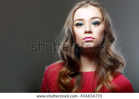Glamour close-up portrait of beautiful woman model face with winged bright blue eyeliner make-up - stock photo
