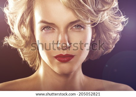 glamour fashion shine portrait of beautiful curly woman in rays of disco light - stock photo