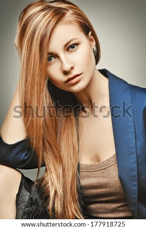 Glamour Fashion Woman portrait. Glamourous model with magnificent hair in a blue business suit. - stock photo