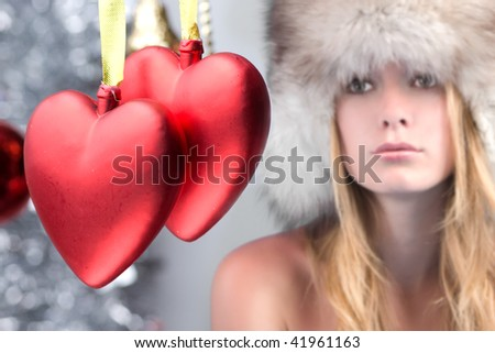 glamour girl and two red valentine hearts. - stock photo