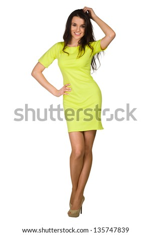 Glamour girl in green dress on white - stock photo