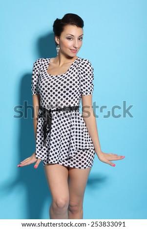 Glamour girl in polka dot dress - stock photo