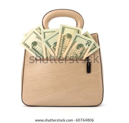 Glamour handbag full with money isolated on white background - stock photo