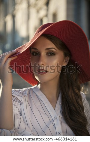 Glamour lady in a red hat