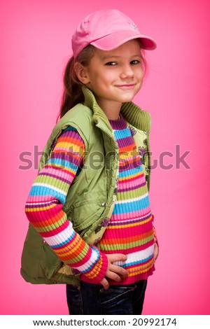 Glamour Little Girl on pink Background - stock photo