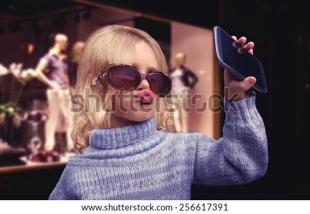 Glamour little girl talks on phone - stock photo