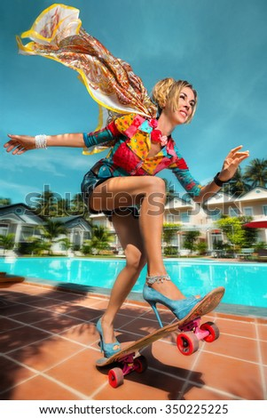 Glamour Model with Skateboard having fun at pool party, enjoy her summer vacation - stock photo