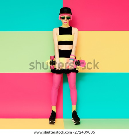 Glamour Model with Skateboard on bright exclusive background - stock photo