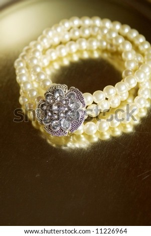 glamour pearl bangle with diamond flower - stock photo