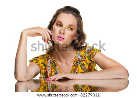 glamour portrait of beautiful curly woman and her reflection in mirror table over white background