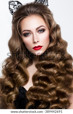 Glamour portrait of beautiful girl model with makeup and romantic wavy hairstyle. Fashion shiny highlighter on skin, sexy gloss lips make-up and dark eyebrows. - stock photo