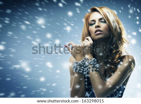 Glamour portrait of beautiful girl over the winter background - stock photo