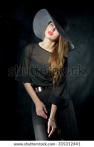 glamour portrait of beautiful sexy young woman with red lips and retro hat