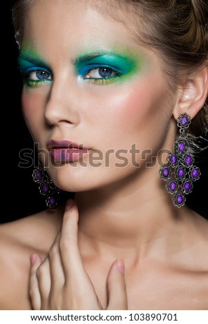 Glamour portrait of beautiful woman model with beautiful evening makeup and hairstyle.