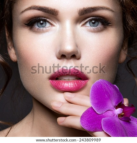 Glamour portrait of beautiful woman model with bright makeup and romantic hairstyle. - stock photo