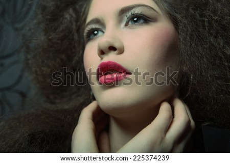 Glamour portrait of beautiful woman model with  bright  makeup and romantic wavy hairstyle