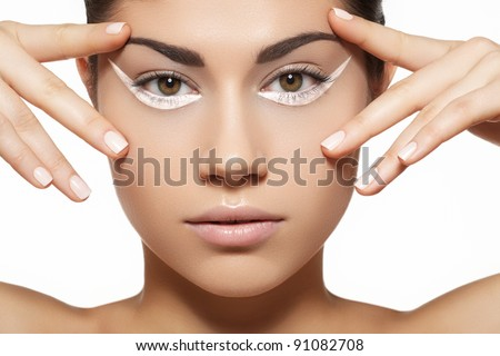 Glamour portrait of beautiful woman model with bright white eyeliner make-up, clean skin and light manicure on nails