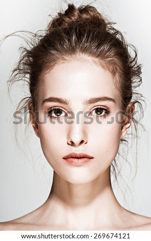 Glamour portrait of beautiful woman model with fresh daily makeup and romantic wavy hairstyle. Fashion shiny highlighter on skin, sexy gloss lips make-up and natural eyebrows - stock photo