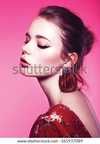 Glamour portrait of beautiful woman model with fresh daily makeup and romantic wavy hairstyle. Fashion shiny highlighter on skin, sexy gloss lips make-up and dark eyebrows,in pink background - stock photo