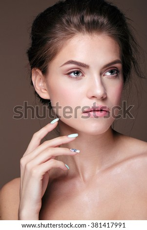 Glamour portrait of beautiful woman model with fresh daily makeup and romantic wavy hairstyle. - stock photo
