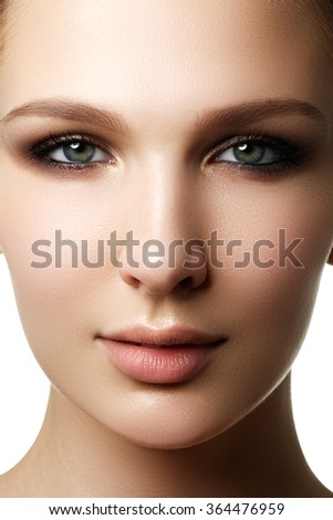 Glamour portrait of beautiful woman model with fresh daily makeup. Fashion shiny highlighter on skin, sexy gloss lips make-up and dark eyebrows - stock photo