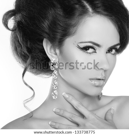 Glamour portrait of beautiful woman model with makeup and romantic wavy hairstyle.