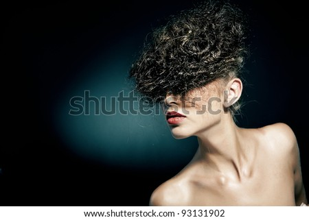 Glamour portrait of beautiful woman on dark background - stock photo