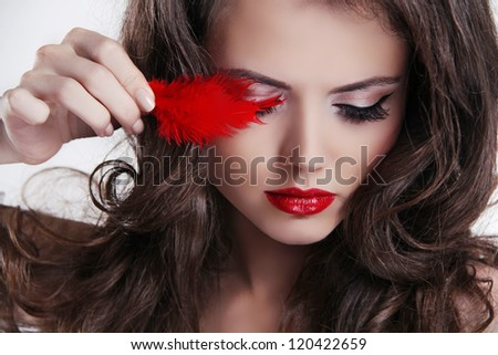 Glamour portrait of beautiful woman with red lips and feather - stock photo
