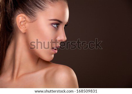 Glamour portrait of beautiful young woman - stock photo