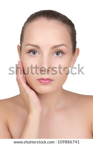Glamour portrait of beautiful young woman touching her face with healthy clean skin isolated on white background