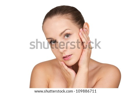 Glamour portrait of beautiful young woman touching her face with healthy clean skin. Spa skin care beauty girl isolated on white background