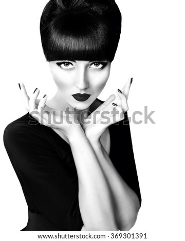 Glamour portrait of elegant brunette retro woman in black and white with hands near face. Professional make up and vintage hairstyle. Vogue style black & white photo.   - stock photo