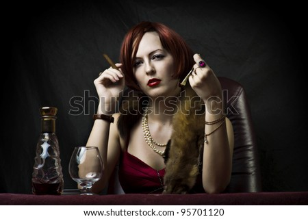 Glamour portrait of sexy woman face with bright evening make up for party and jewelry gold rings with precious stones sitting on the table