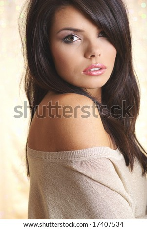 Glamour portrait of sexy woman. gold background - stock photo