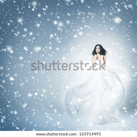 Glamour portrait of young and attractive woman with makeup and romantic wavy hairstyle over the winter background - stock photo