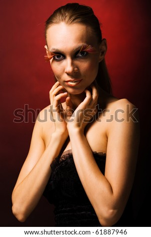 Glamour portrait of young fashion model with face art - stock photo