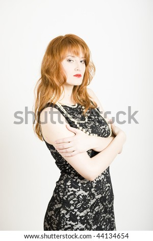 Glamour portrait of young sexy woman in elegant black dress - stock photo