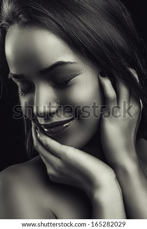 glamour portrait smiling beautiful young woman in black white
