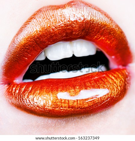 Glamour Red gloss lips with sensuality gesture.
