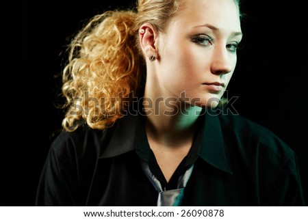 Glamour seductive woman in earrings on black background, looking at camera. Studio portrait. - stock photo