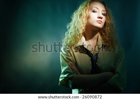 Glamour seductive woman portrait in shirt and tie looking at camera. Specific lighting. - stock photo