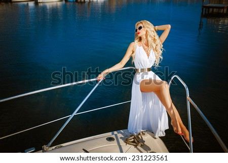 Glamour sexy woman vogue style model on yacht luxury lifestyle, fashionable tanned woman portrait sea vacation, Sensual blonde beautiful woman, Girl with perfect body and long healthy hair,  - stock photo