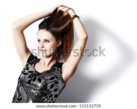 Glamour shot of a beautiful caucasian woman against the white background