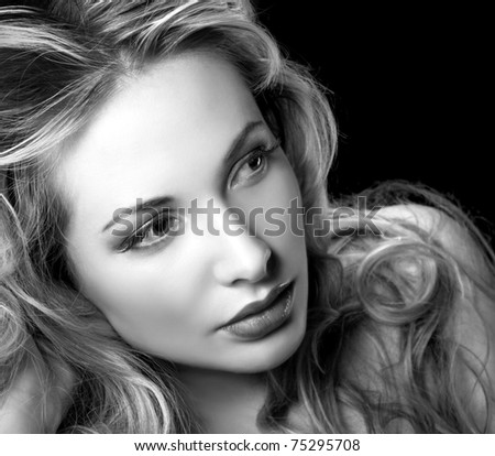 Glamour style portrait of pretty woman in Black & White