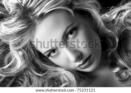 Glamour style portrait of pretty woman.White and Black - stock photo